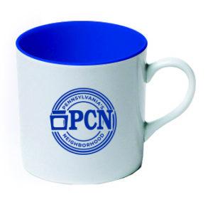 white mug with blue interior and blue PA's Neighborhood logo