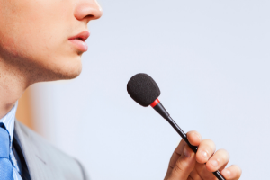 Person speaking into microphone